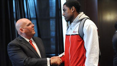 Jeff Bower (left) greets players in April 2013, when he was introduced as the Marist College men's basketball team's head coach.