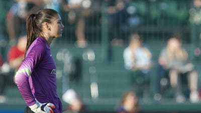 Hope Solo made three saves, including an acrobatic dive and tip in the 75th minute, to help keep Seattle unbeaten on Wednesday with a 2-1 win over the WNY Flash.