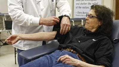 Robin Green braved the snow storm to make her regular donation of blood at the Red Cross.