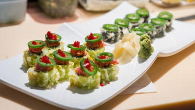 The staff at Sushi De Kanpai in downtown Salisbury offers tips on making expert sushi rolls.