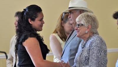 Philanthropist Pat Lanza, right, congratulates El Centro Hispano scholarship winner Brenda Lopez in 2012.