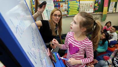 Student teacher Samantha Felder works with first-grader Shea Hollwedell at the Park Avenue School in Port Chester. Felder is completing a master's degree at Manhattanville College.