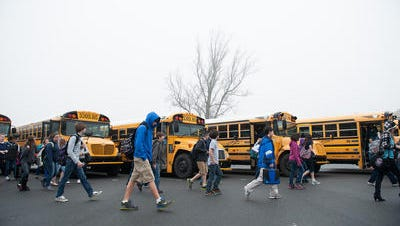 Students get off buses at Lake Forest School District's W.T. Chipman Middle School in Harrington.
