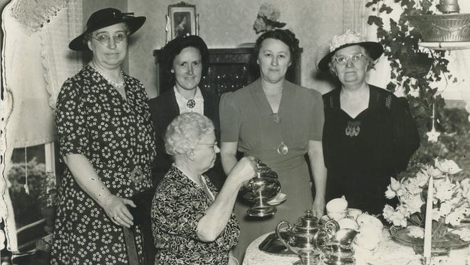 Members of the Women's Missionary Society of the Washington Street Methodist Church attend a tea at the home of Mrs. Benjamin F. Shorter. From left are Mrs. Charles Van Keuren, Mrs. E.H. Douglas, Shorter, Mrs. James W. Watts and Mrs. F.P. Fraleigh in front pouring tea.