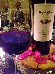 A bottle of wine is the centerpiece, of course, at a wine dinner featuring Franciscan Winery of Napa Valley.