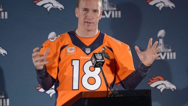 Jan 30, 2014; Jersey City, NJ, USA; Denver Broncos quarterback Peyton Manning (18) at a press conference in advance of Super Bowl XLVIII on the Cornucopia Majesty yacht on the Hudson River. Mandatory Credit: Kirby Lee-USA TODAY Sports