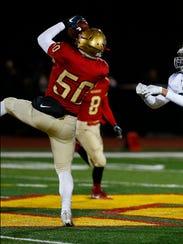 Mount Olive senior linebacker Ryan Hodgins intercepts