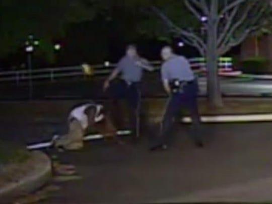 Dover Police Cpl. Thomas Webster IV (center) kicks