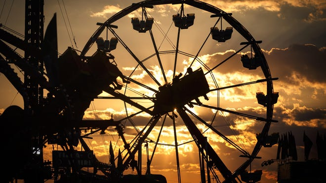 The sun sets over the Midway during the 2017 Illinois State Fair at the Illinois State Fairgrounds, Thursday, Aug. 17, 2017, in Springfield, Ill.
