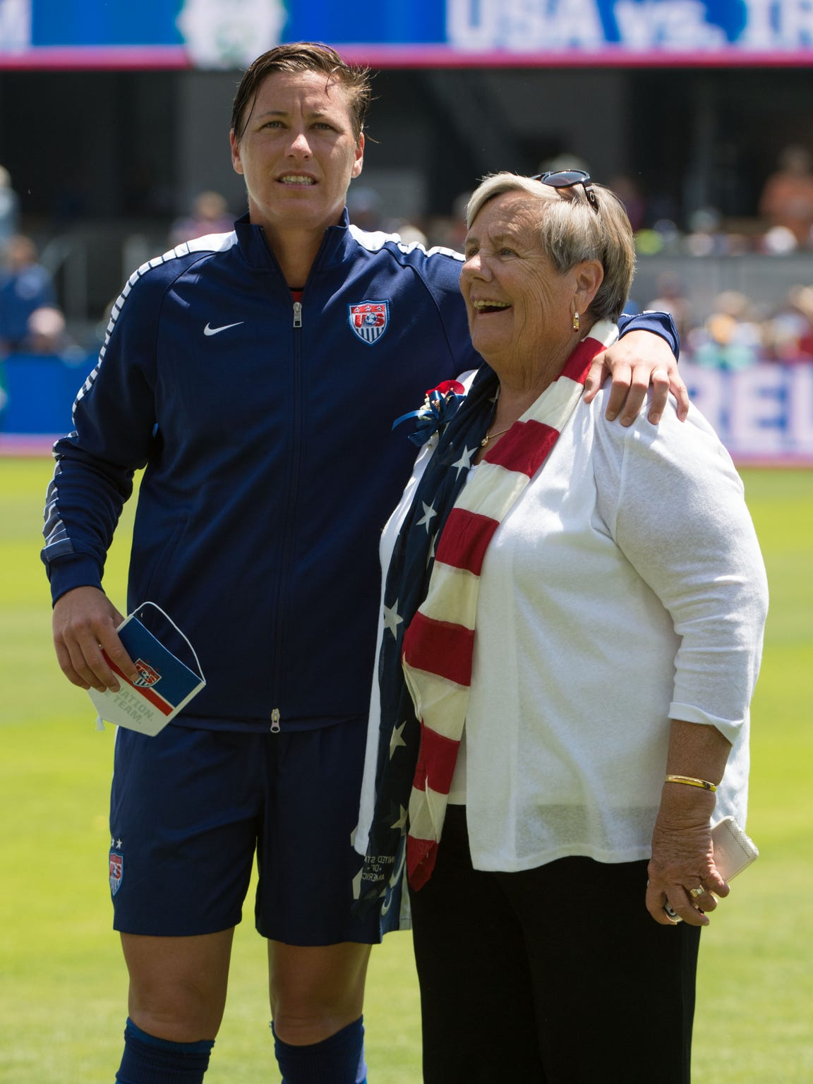 Abby Wambach is escorted onto the field by her mom Judy Wambach before a match against Ireland at Avaya Stadium on May 10.