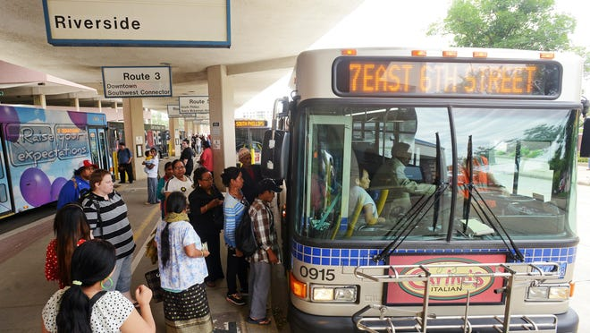 Riders load onto a Route 7 bus Tuesday evening at the Sioux Area Metro downtown station, June 23, 2015.