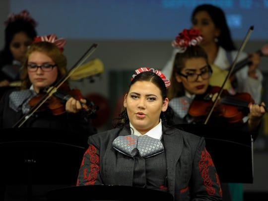 Selena Patty of the Glencliff High School musical group Mariachi Internacional de Nashville performs Monday, Sept. 12, 2016, in Nashville.