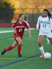 Red Hook's Lauren Engel, left, rushes the ball as Wallkill's