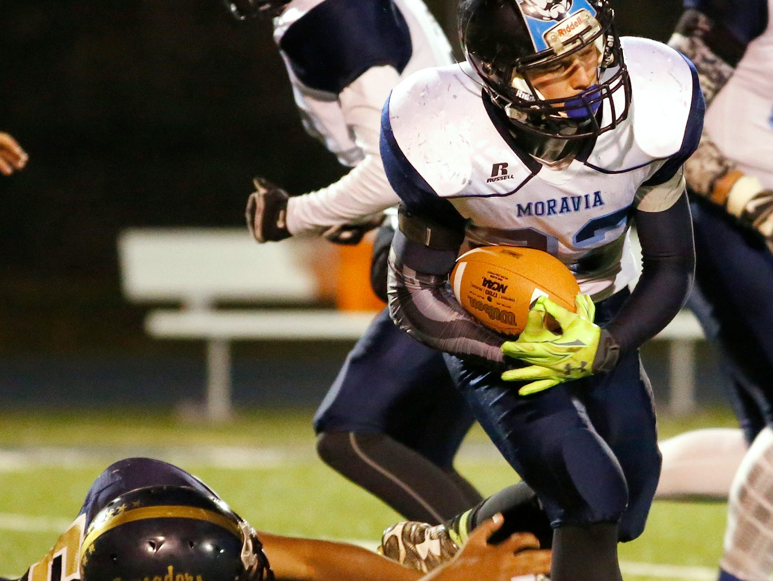 Notre Dame's Dimitrius Stanley grasps at Moravia's Jared Lyon Friday night in the second quarter.
