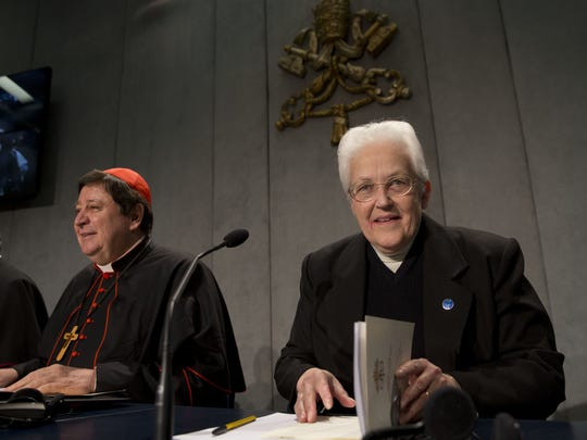 Sister Sharon Holland, right, arrives for a press conference at the Vatican, Tuesday, Dec. 16, 2014.  (AP Photo/Andrew Medichini)