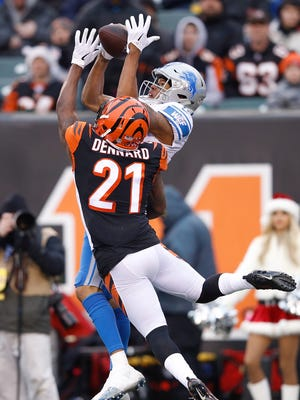 Lions WR Marvin Jones makes a catch defended by Bengals CB Darqueze Dennard during the second half on Sunday, Dec. 24, 2017, in Cincinnati.
