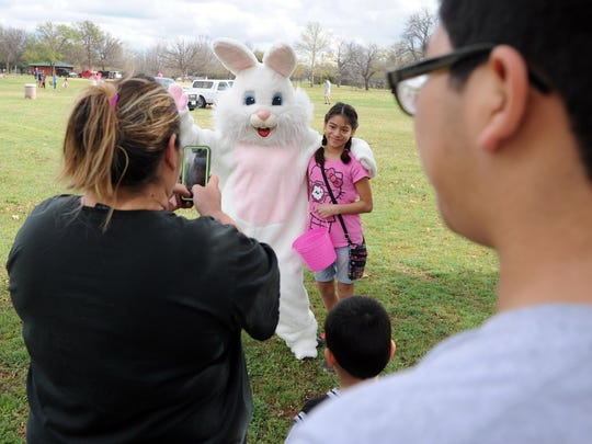 Reyna Bocel has her picture taken with the Easter Bunny