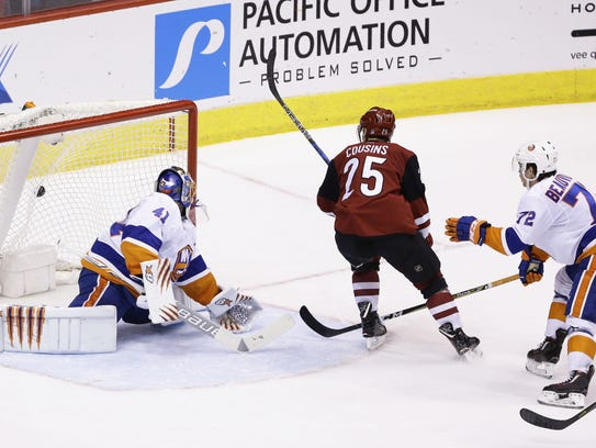 Nick Cousins scores the winning goal in overtime on Monday.