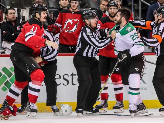 New Jersey Devils center Brian Boyle (11) has words with Dallas Stars defenseman Greg Pateryn (29) after scoring a goal during the second period at Prudential Center in Newark on Friday, Dec. 15, 2017.