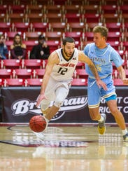 SUU's Jadon Cohee looks to make a move around a San Diego Christian defender during the Thunderbirds' home win last weekend.