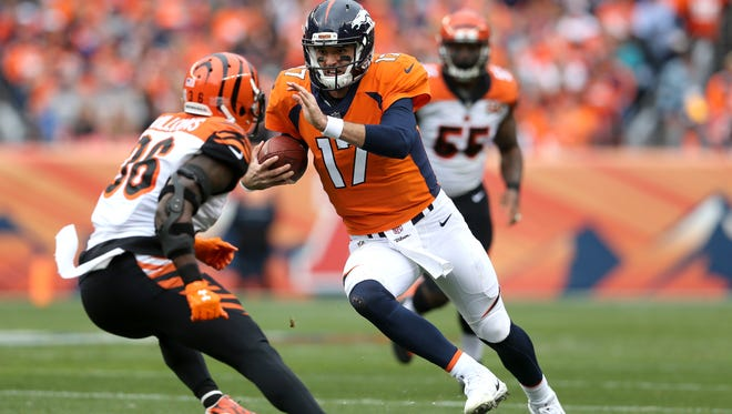 Denver Broncos quarterback Brock Osweiler (17) braces for a tackle by Cincinnati Bengals strong safety Shawn Williams (36) in the first quarter during the Week 11 NFL game between the Cincinnati Bengals and the Denver Broncos, Sunday, Nov. 19, 2017, at Sports Authority Field at Mile High in Denver, Colorado.