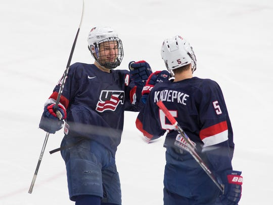 Exchanging high fives after a goal Friday night are NTDP Under-18 players Josh Norris (left) and Nate Knoepke.