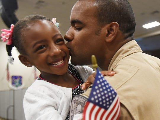Capt. Tico Sellers kisses his daughter Natalia Sellers