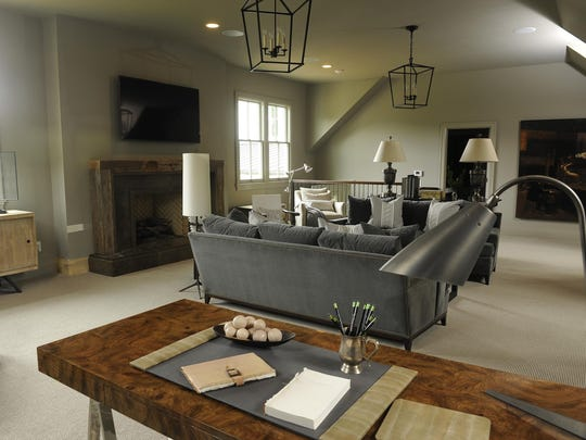 The lounge features warm woods and charcoal gray furnishings.