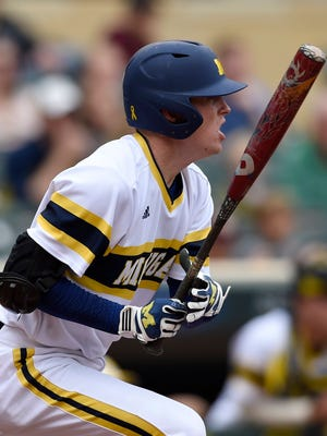 Michigan's Jacob Cronenworth (2) watches his two RBI single off Illinois starting pitcher Rob McDonnell (16) during the second inning of a fourth-round NCAA Big Ten tournament college baseball game Saturday, May 23, 2015, in Minneapolis.