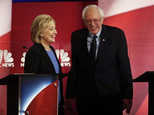 Hillary Clinton and her Democratic rival Bernie Sanders talk after the candidate debate in Charleston, S.C.