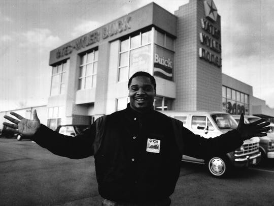 Bengals running back Ickey Woods was photographed March 27, 1990, preparing for his future by working as a car salesman.