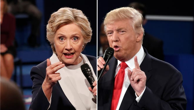 Democratic presidential nominee Hillary Clinton and Republican presidential nominee Donald Trump exchange views during the second presidential debate at Washington University in St. Louis.