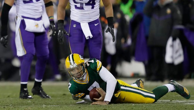 Green Bay Packers quarterback Brett Hundley (7) is stopped on third down forcing a punt in the third quarter against Minnesota Vikings outside linebacker Anthony Barr (55) and middle linebacker Eric Kendricks (54) Saturday, December 23, 2017, at Lambeau Field in Green Bay, Wis.