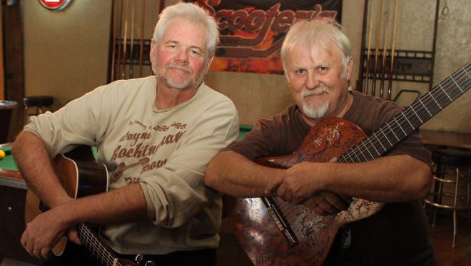 Old friends and fellow musicians, Richard Stevens, left, and Bobby Keel prepare for a fundraiser this weekend that will honor their friend Wayne Brown, one of the founding members of the Ballistic Pintos.