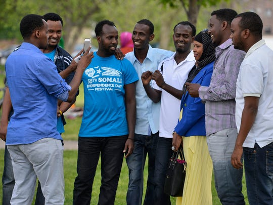 Participants in Sunday's Somali Independence Day celebration gather for a quick photo.