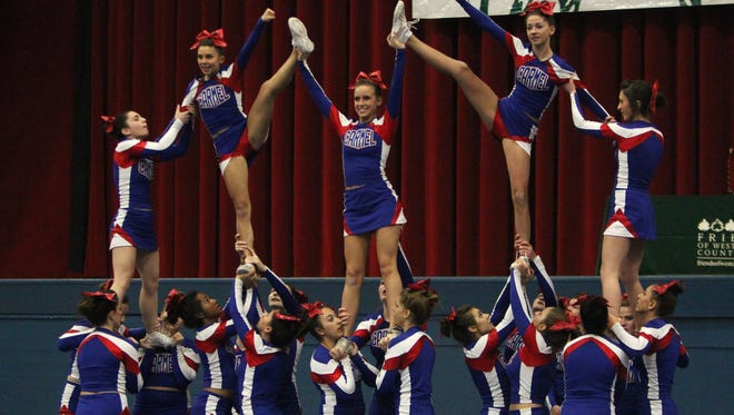 Carmel won the Varsity II large division title at the 65th Annual Westchester County Cheerleading Invitational at the Westchester County Center on Nov. 26, 2013.