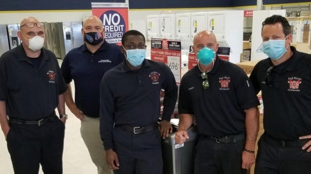 Employees of the Globe Street Fire Station visited American Freight and picked out new appliances and furniture for the Globe Street location.