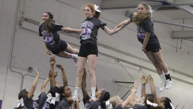 Members of New Rochelle's cheerleading team practice at New Rochelle High School's gym in preperation for the upcoming state championships, which will take place at Syracuse on Saturday, March 5th.