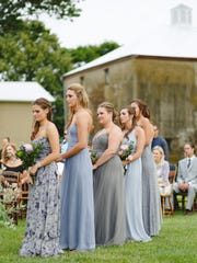 Bridesmaids gather at a wedding ceremony at Johnson's Locust Hall Farm in Jobstown.
