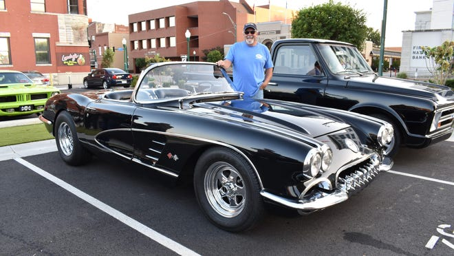 Gerald Driscoll stands by his eye-catching 1960 Chevrolet Corvette on Sept. 24 in downtown Fort Smith. Every Thursday from 5:30-8 p.m., the parking lot at the corner of Garrison Avevenue and 6th Street, across from First National Bank, is full of classic cars and trucks.