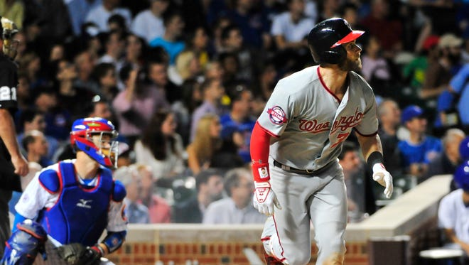 Bryce Harper watches his home run during the sixth inning.