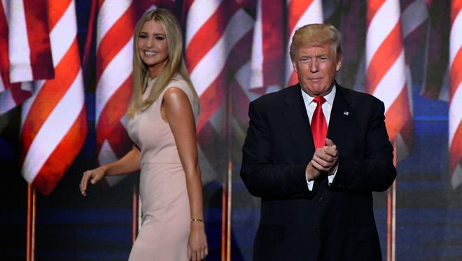 Donald Trump walks on stage prior to speaking as his daughter Ivanka Trump leaves the stage during the 2016 Republican National Convention at Quicken Loans Arena.