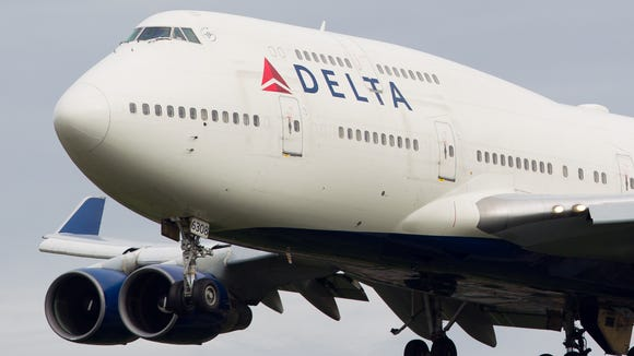A Delta Air Lines Boeing 747-400 is seen in flight