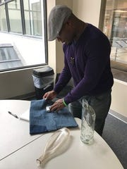 Brian Booker, founder and CEO of One Step Initiative, displays bags and bottles that Ghanaians created from discarded denim, glass and aluminum. Fourteen students from Memphis learned about such resourcefulness during a recent study trip to that West African nation.