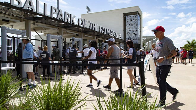 Fans enter FITTEAM Ballpark of the Palm Beaches for the last spring training game this season in West Palm Beach on March 12. MLB suspended spring training games and to delay the start of the 2020 regular season due to the national emergency caused by the coronavirus pandemic.