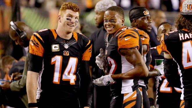 Bengals quarterback Andy Dalton, left, and wide receiver Marvin Jones smile as the second half comes to a close Thursday November 4, 2015 at Paul Brown Stadium. The Bengals beat the Browns, 31-10, and are 8-0.