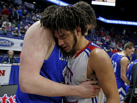 Scott County's Michael Moreno, right, gets a hug from