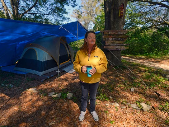 Rhonda outside her tent home at Satoshi Forest.
