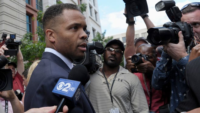In this Wednesday, Aug. 14, 2013, file photo, former Illinois congressman Jesse Jackson Jr., leaves federal court in Washington.