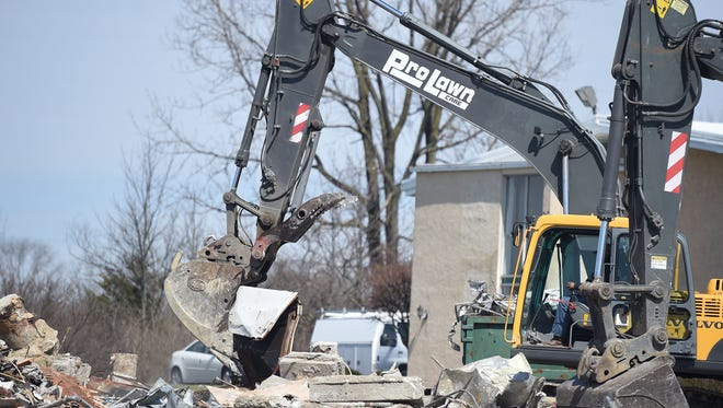An excavator is used to clear what is left of the former Chinese Buffet Thursday, March 23, 2017 along Chester Boulevard in Richmond.